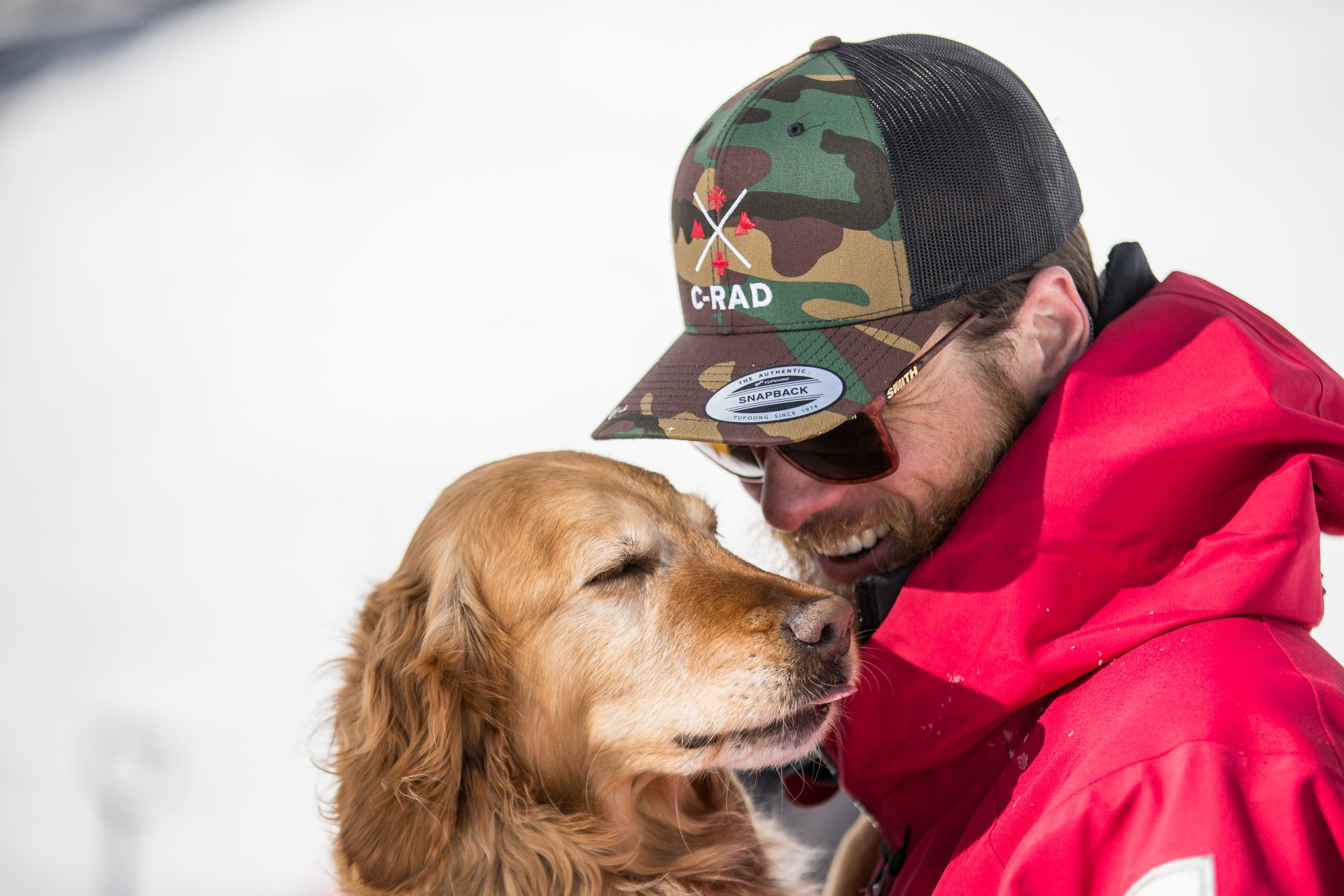 Dog handler with dog and C-RAD hat