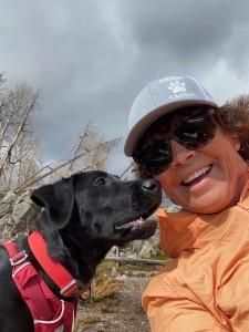 Black lab with dog handler