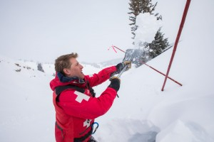 Avalanche technician diggin in the snow during training